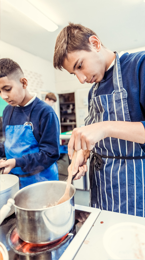 Boys at Gosforth Academy cooking